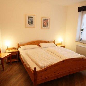 Ferienwohnung Bunte Kuh Petersdorf Schlafzimmer 1